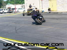 stunt bike, friends in low places, car show