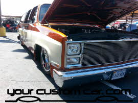 two tone suburban, on air bags, friends in low places, car show