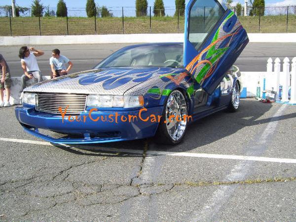 Custom Cadillac Lambo Doors Big Wheels