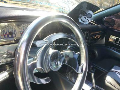 The interior features an array of polished billet aluminum items, suede and leather seat upholstery and fully smoothed and fiberglassed (except for the carpet! LOL) interior.